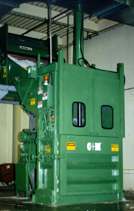 C&amp;M Rear Feed Vertical Balers